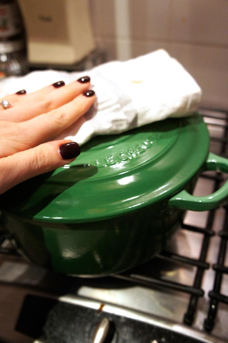 Hand on pot lid